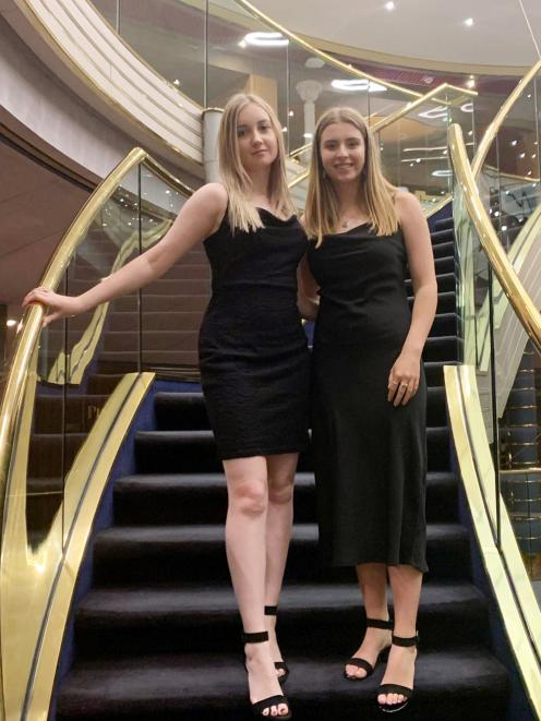 Enjoying a formal night while stranded on board a cruise ship barred from docking over...