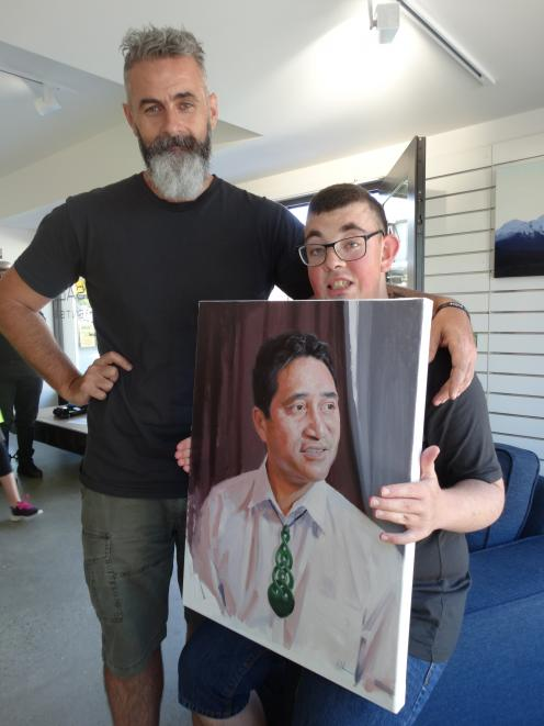 Stephen Martyn Welch with his son Scott and his portrait of Paul Tamati prior to his ''Everyone Deserves a Portrait'' exhibition last year. Photo: Mark Price