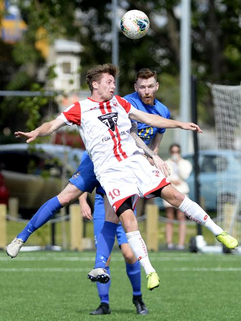 Waitakere United's Jake Porter (front) looks to head the ball, as does Southern United defender...