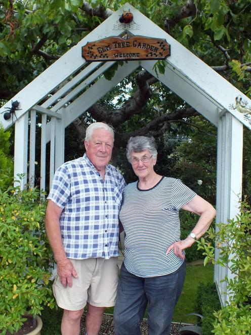 Richard and Myra Wells in front of the elm tree that gives their Abbotsford garden its name.