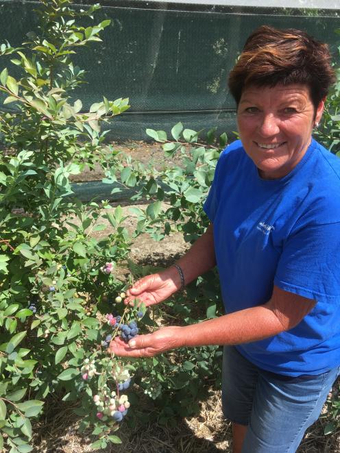 Robyn McDonald shows off a crop.