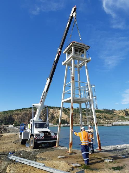 A telehandler is used to take the Oamaru Harbour breakwater navigational aid away to be treated for rust. Photo: Supplied