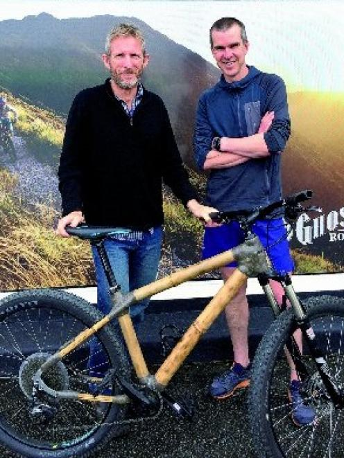 Richard Nichol (left) with the custom-built bamboo bike made for him by Glenn Irving, using...