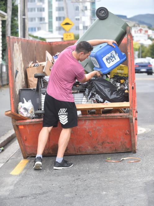 A student dumps his rubbish in Clyde St in the free Skips for Students. PHOTO: PETER MCINTOSH