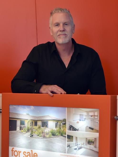 Live Sign founder Wayne Magee shows off his new eco-friendly real estate sign.