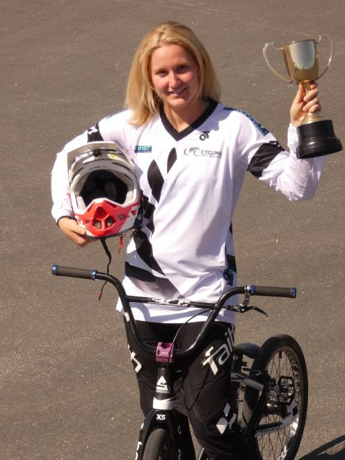 Holly Oldham has reason to celebrate after winning the junior women category at the NZ BMX...