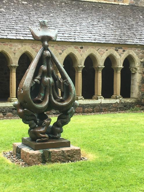 The sculpture The Descent of the Spirit in the Iona abbey cloister.