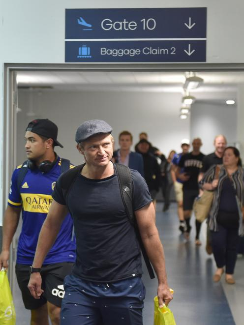 Highlanders assistant coach Tony Brown and inside back Josh Ioane arrive at Dunedin Airport yesterday. Photo: Gregor Richardson