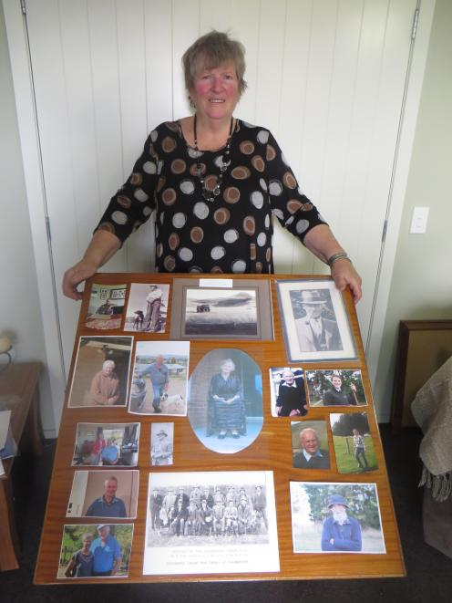 Palmerston Collie Club stalwart Margaret Vickers has put together a photo board of past presidents and secretaries as part of the commemorations for the club's centennial year. Photo: Supplied