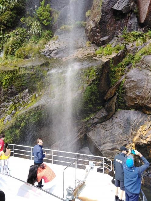 Getting up close and personal with one of Milford Sound's many waterfalls. PHOTOS: REBECCA FOX