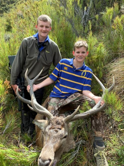 Brothers Archie (left) and Riley McRae display a trophy stag. PHOTO: SUPPLIED