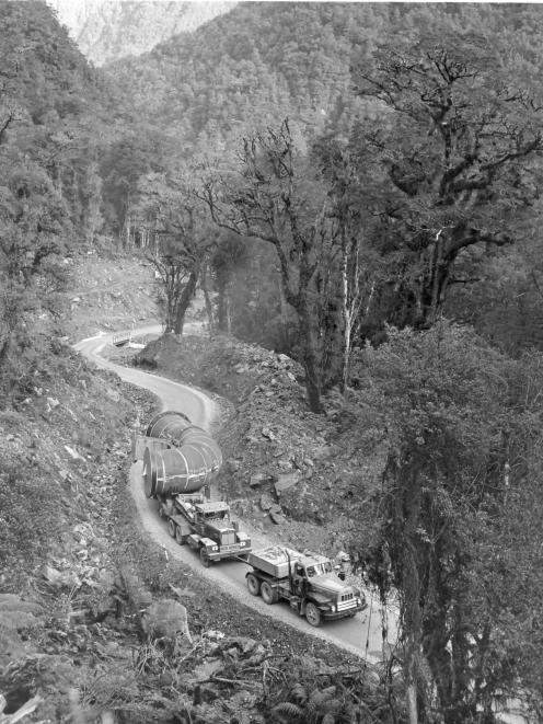 Transporting a pipe section over Wilmot Pass to West Arm. PHOTO: SUE AND ALAN MARCHANT COLLECTION...