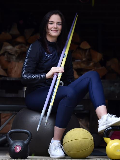 Paralympian Holly Robinson takes a break from training at her flat in Dunedin yesterday. PHOTO:...