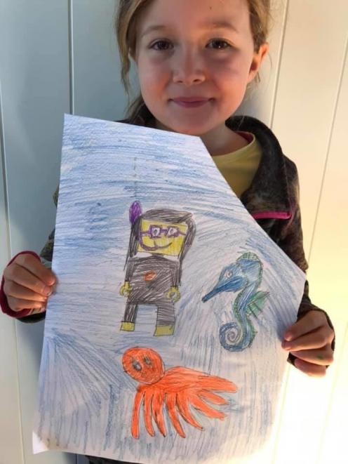 Olive Johnstone (6) drew a scuba-diving scene that won her a brand-new Lego set. PHOTO: SUPPLIED