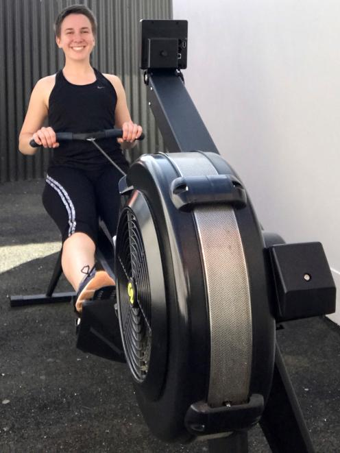 Otago University Rowing club member Hannah Zwalue warms up for the Anzac Day Indoor Rowing...