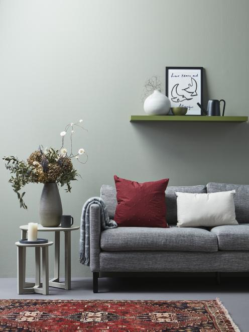 Soft greens like Resene Peace (on the back wall) and Resene Suits (on the wall to the right) are...
