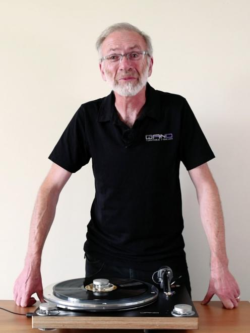 Good vibrations ... Simon Brown stands with the Wand Tonearm and Turntable combination he has...