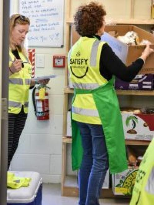Satisfy Food Rescue volunteers Lisa and Pauline sort through food ready to distribute to local...