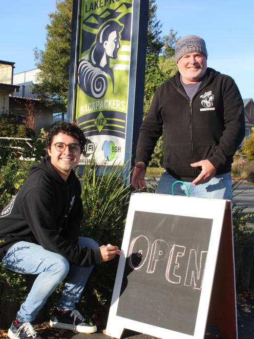 Te Anau Lakefront Backpackers receptionist Giovanni Gomez and owner Dean Costello invite guests...