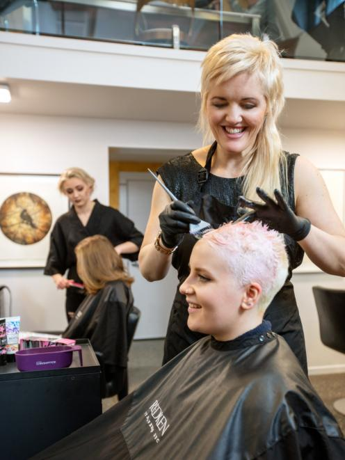 Nearly back in business ... Timely client Kylie Hayes, of Moha Hairdressing, cuts hair before the...