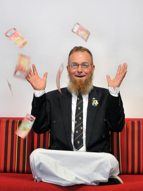 New Zealand Education Foundation director Paul Gourlie with $1000 he never knew he had. PHOTO:...