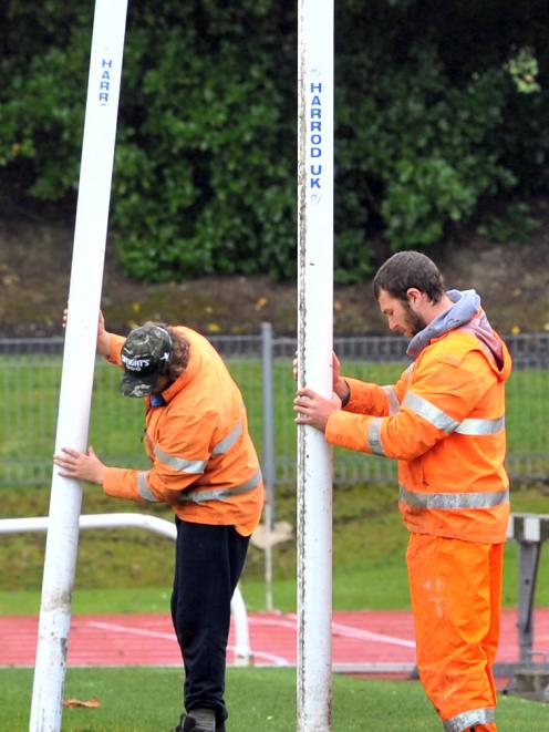 Delta workers Simon Smaill (left) and Will Young  get ready to put in the goalposts for the...