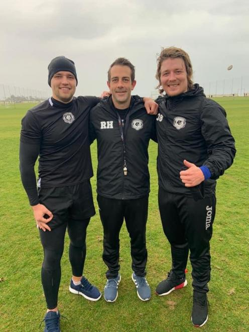 Christchurch strength and conditioning coach Robbie Harlow, centre with two professional rugby...