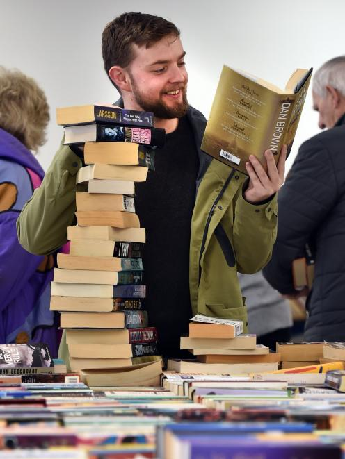 Student Jake Ward (23), of Dunedin, with his stack of books, during the Regent Theatre Pop-up...