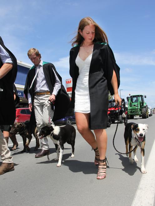 Happy day...McKenzie Bird walks with Jane her dog in the Telford graduation parade in Balclutha...