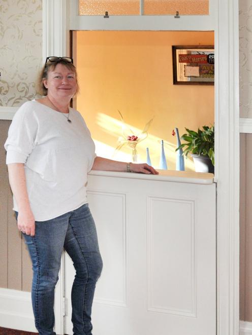 Penny Turner at the split stable door dividing the former bar from the hallway. Photos: Christine...