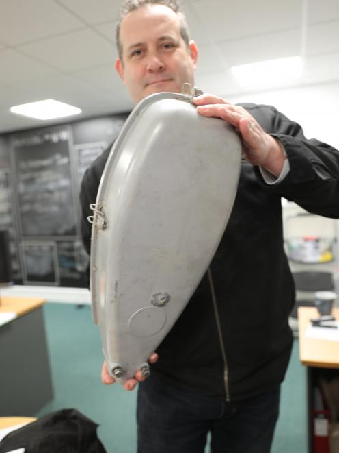 Waitaki District Council road safety co-ordinator Jason Evered holds a streetlight that was shot....