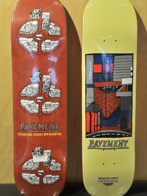 A skateboard depicting the Octagon, painted by Callum Parsons, and another depicting the Library...