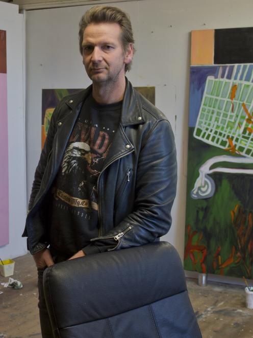Artist Pete Wheeler takes a break in his make-shift Dowling St studio. PHOTO: GERARD O'BRIEN