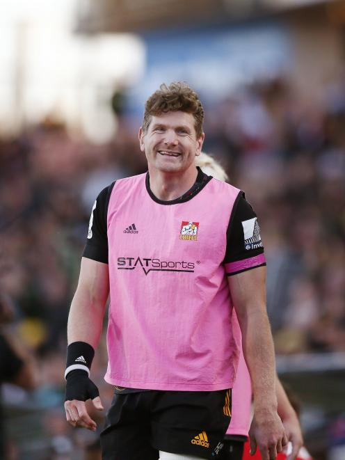 Adam Thomson warms up on the sideline during the Chiefs' round 6 Super Rugby Aotearoa match...
