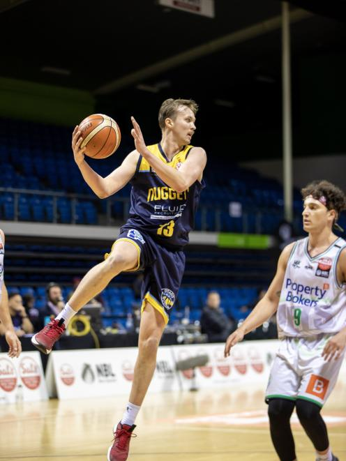 Otago Nuggets' swingman Josh Aitcheson gathers the ball against the Manawatu Jets early in the...
