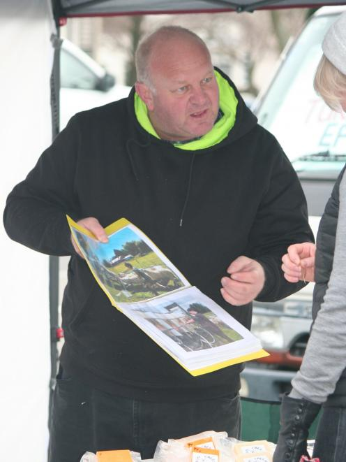 Hipi Cheese owner Allan Ramsay talks to a customer about the boutique sheep operation during the...