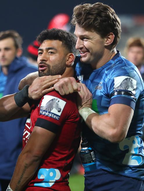 Richie Mo'unga and Beauden Barrett share after the game. Photo: Getty Images