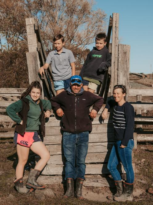 Back left, Lachie (11) and Bayden (10), front left, Jenna (13), Scott and Joy Clearwater have...