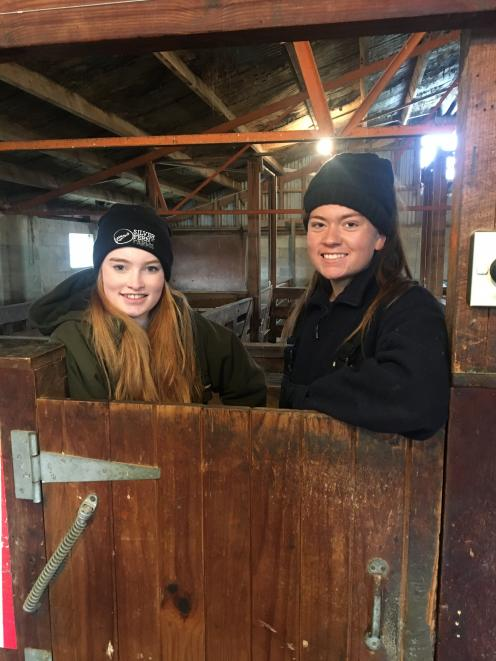 Spending time in a woolshed are Katie Gunn (17, left), of Roxburgh Area School, and Bella...