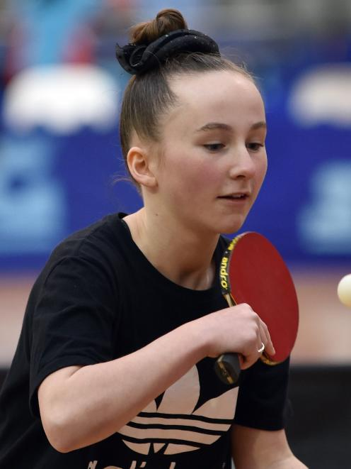 Southland's Zoe Gray (12) hits the ball during an under-13 doubles final.