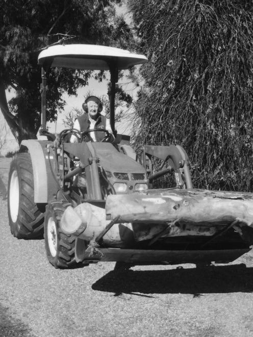 Jill Blennerhassett on her tractor at the Olive Grove wedding venue on Barn Pinch farm, part of...