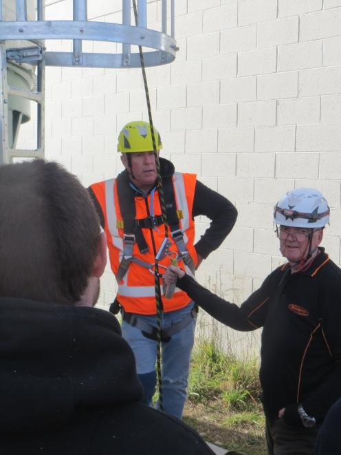 Tutor Jeff Taylor-Hurst, of Compliance Partners, gives instruction on working at height to...