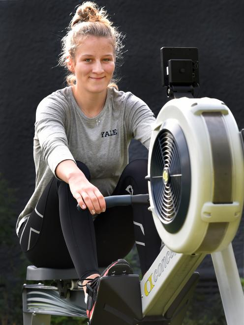 Eva Hofmans on her rowing machine at home. PHOTO: PETER MCINTOSH