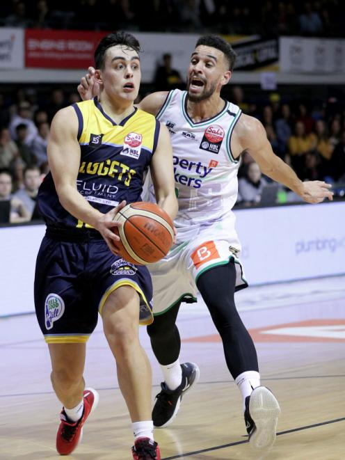 Otago Nuggets guard Richie Rodger takes the ball to the hoop as Manawatu Jets guard Nelson...