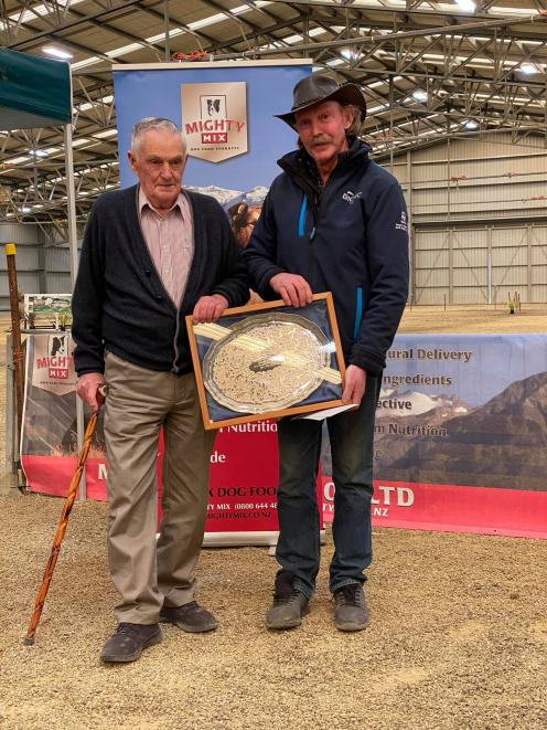 Les Roughan (left) presents Central Otago triallist Bill Hinchey with the Joan Roughan Memorial...