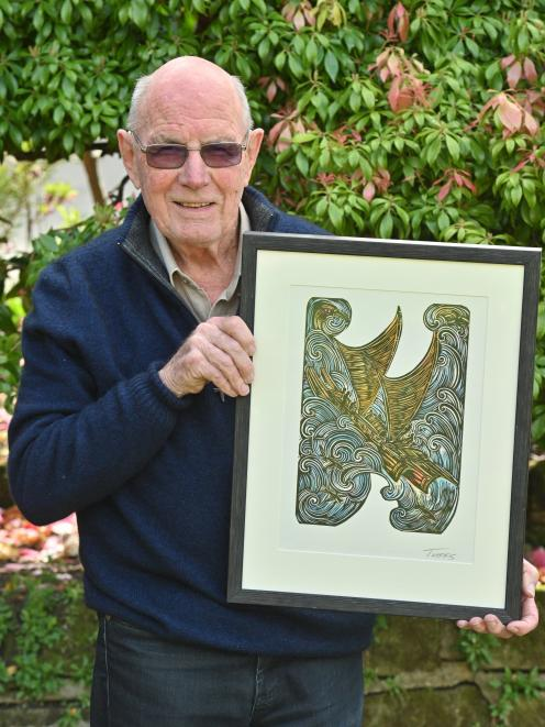 Bill Dawson, of Dunedin, holds a custom-made piece by artist Michel Tuffery that was given to him...