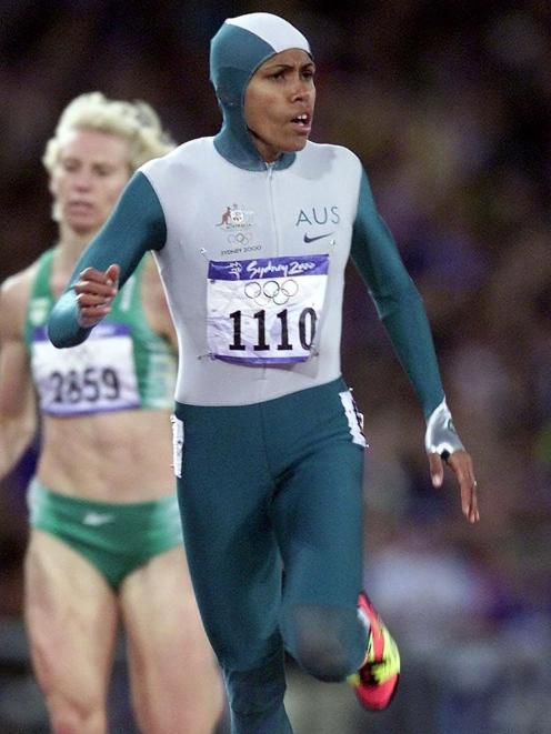 Australia's Cathy Freeman wins the 400m final at the 2000 Sydney Olympic Games. PHOTO: REUTERS
