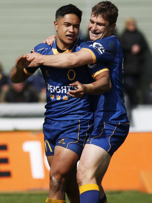 Otago centre and captain Michael Collins congratulates Ioane.