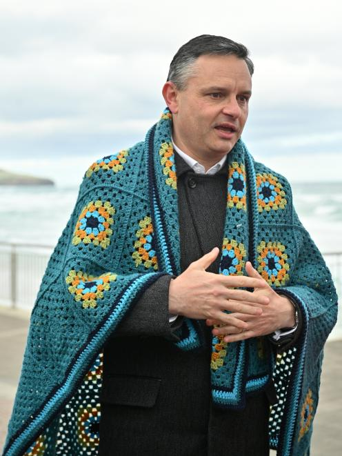 Green Party co-leader James Shaw rugged up with a crocheted blanket given to him by a party...