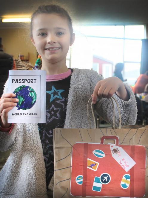 Zoe Brinkworth (7) proudly shows the luggage she created to carry the crafts she did during the...